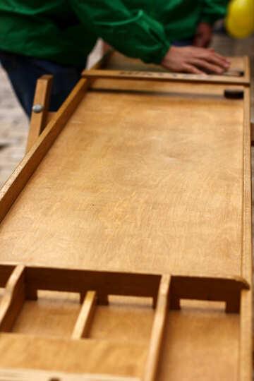man touching furniture wood game table wooden stuff №51014