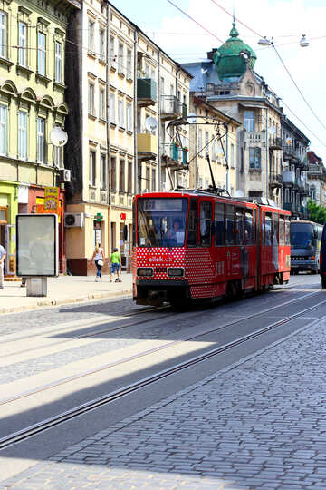 A red tram train on the city road №51725