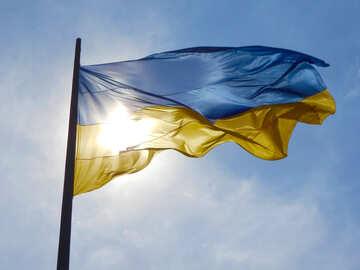 Ukrainische Flagge mit der Sonne dahinter Blau und Gelb №51270