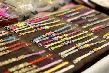 many colors of buckle-fastening thin bracelets with bands or beads decorating top middle №52981