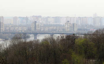 Beautiful place with trees and bridge city Kyiv landscape skyline over water №52416