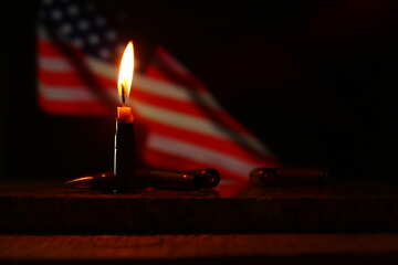 a candle in front of an american flag №52523