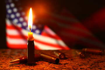 american flag behind lit candle, bullet on floor №52509