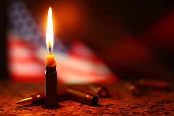 a lit candle with the American flag in the back №52517