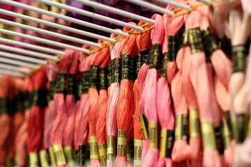 A rack of threads being displayed for sale. №52548