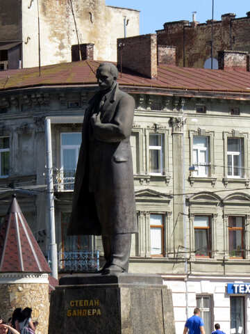 Stepan Bandera statue of a man in a town front of building middle city sclpture №52209