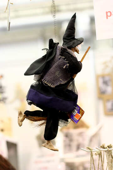 A person dressed as a witch running wich black №52786