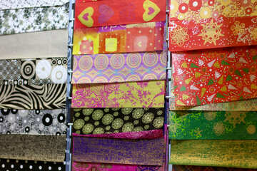 Display of different multi coloured and patterned materials samples patterns squares fabrics №52776