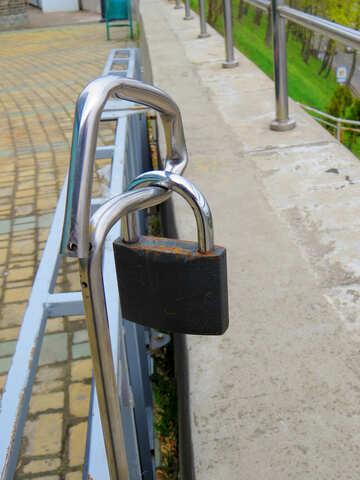 a lock on a hand rail Padlock railing with walkway №52429