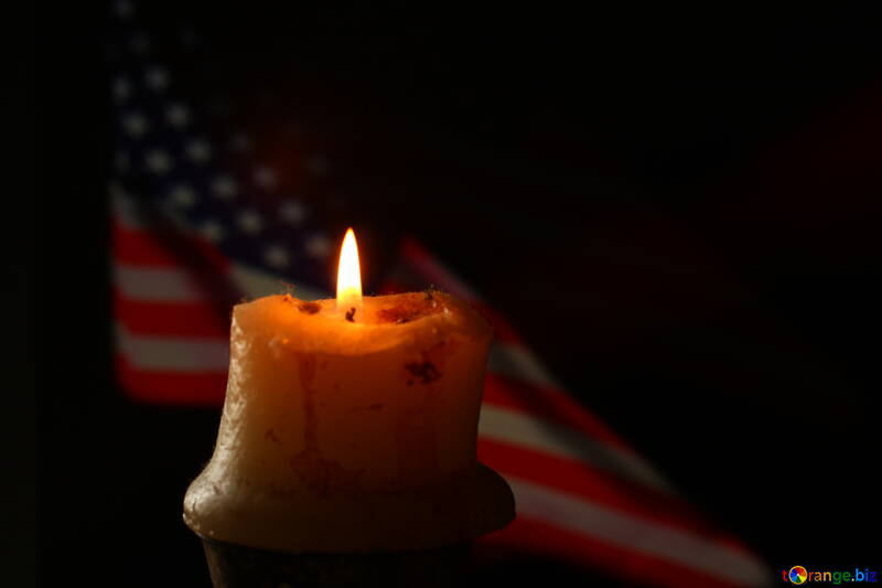 A candle and american flag behind candle №52482