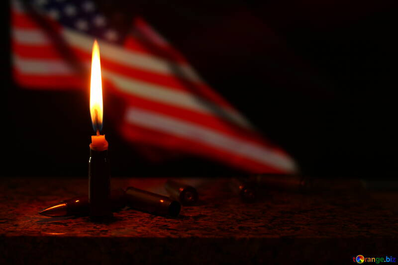 USA flag behind a candle that is lit №52525