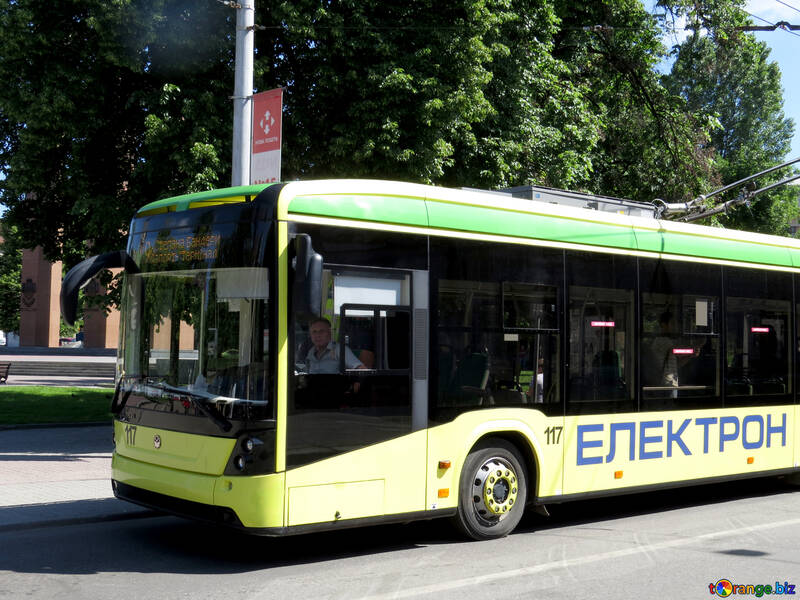 Bus on a sunny street with cyrillic words electron on the side №52208