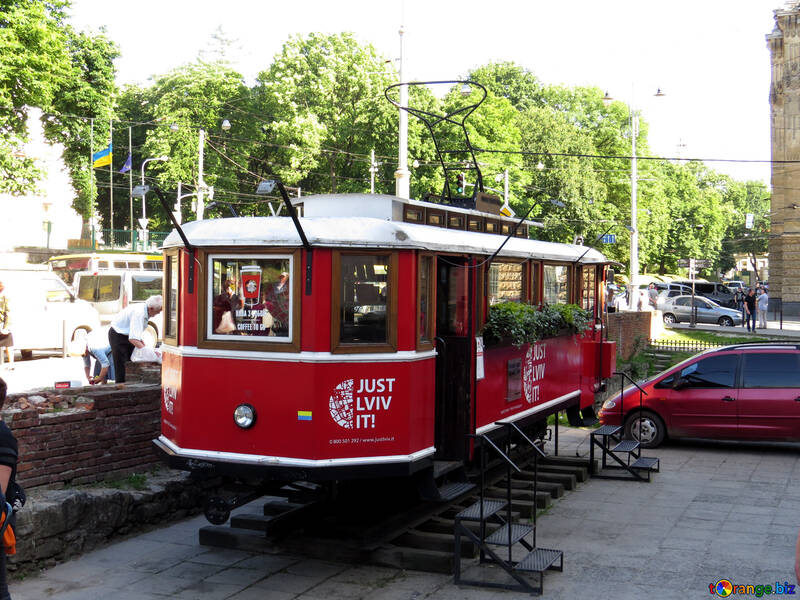 tram with stairs next to a red car №52160