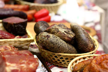 Meat Bread in a basket and other foods on a table №53032