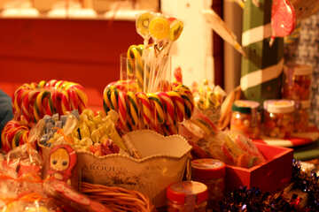 Candy canes on a table decoration and sweets Christmas sugars №53498