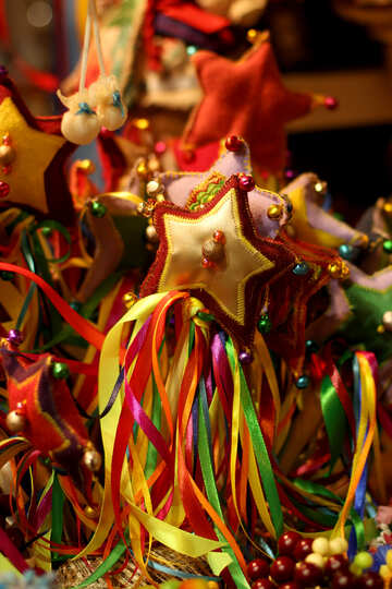 a party happening and lots of streamers Christmas decorations star with ribbonets colorful №53503