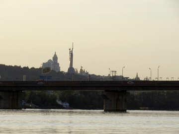 bridge over a river with suburban skyline №53452