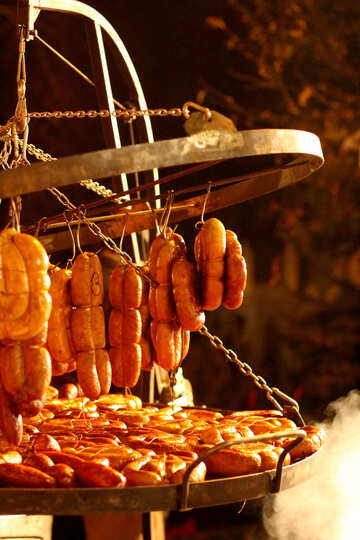 Sausages on a rack being cooked №53543