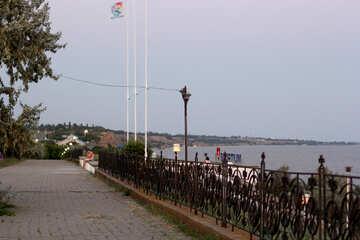 Walkway fence sidewalk, park near sea sky beach road street by water №53220