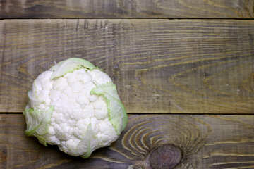 a head of cauliflower on wooden  table №53654