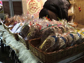 baskets of bread, a man cartoon face on the wall cookies Food for sale. №54123