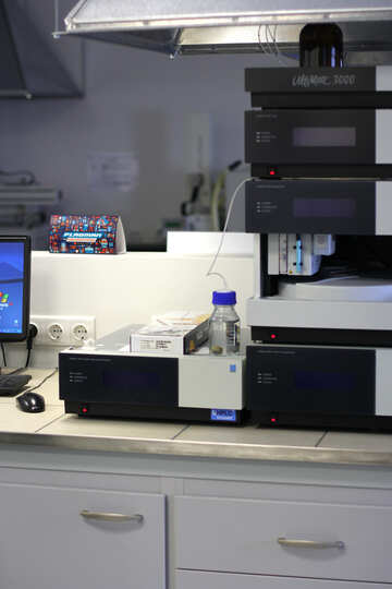 A lab with machines analysing some liquid working room №54662