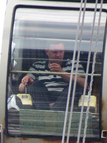 Man t shirt drink behing mirror transport crane №54131
