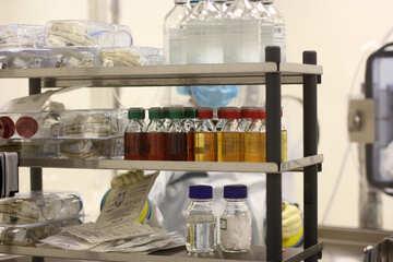 An open shelf with bottles of liquid and other supplies medicine  shelf bottles №54556