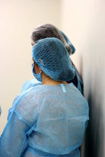 woman wearing blue medical coverings doctor doctor №54614