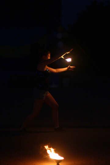 a girl holding light flame Fire dancing №54379