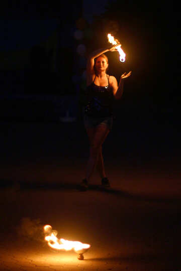 A dancer with fire on her hand Woman with fire Flames slowmotion №54381