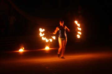 Man holding flamesticks dancing Fire №54395