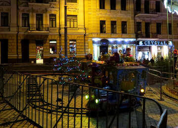 A street at night with railings mini train lights №54094