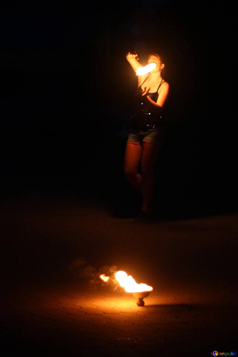 woman with a candel fire dancer flames firework light №54382