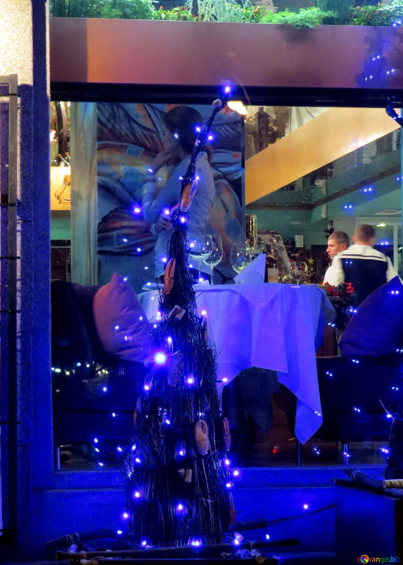 purple tree lights statue dancer people restaurant window sparkle background №54062