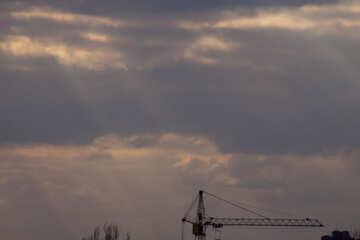 Lifting Crane at under construction rays Sun №7506