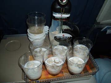 Drinks   airplane . Liquor  Sheredan  with  ice. №8013