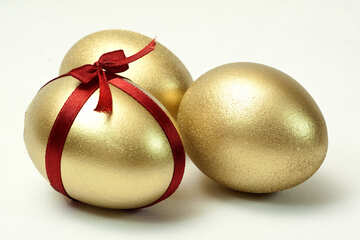 Three  gold  eggs  at  Easter. №8232