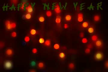 The effect of the dark. Very Vivid Colours. Blur frame. Card with text Happy New Year.