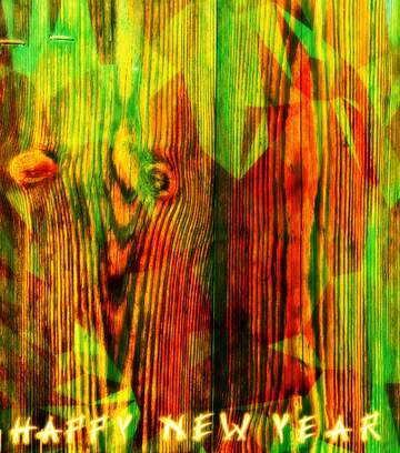 L'effetto della molto luce. I colori molto vivaci. Card with text Happy New Year.