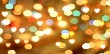A bokeh lights background with big hearts