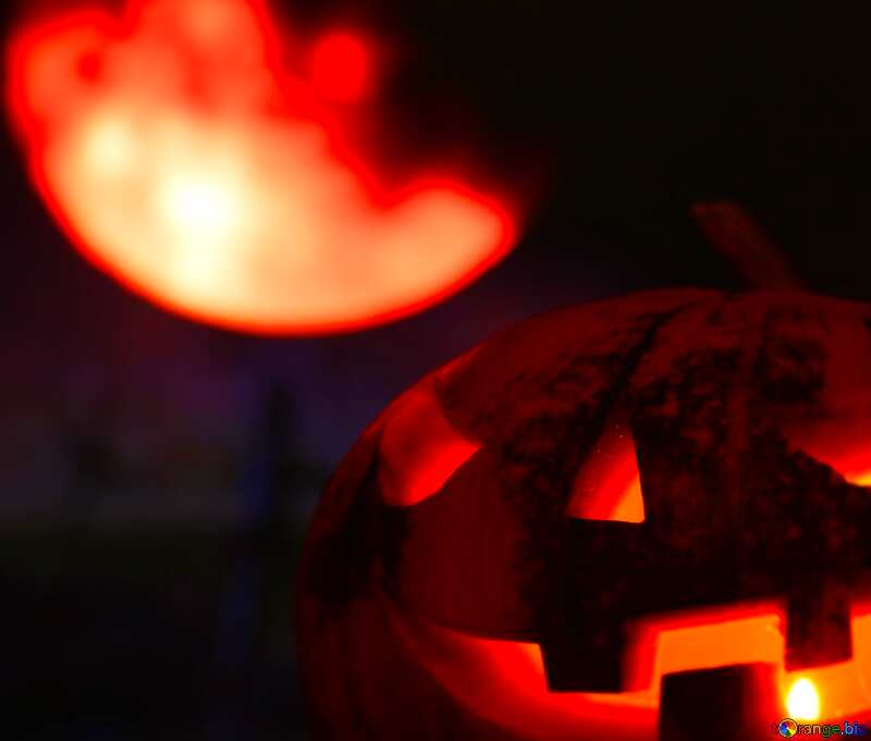 A jack-o-lantern in front of a red moon №46162