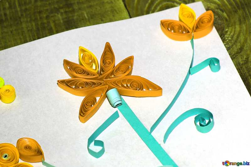 a orange flower cut from paper by childrens №36322